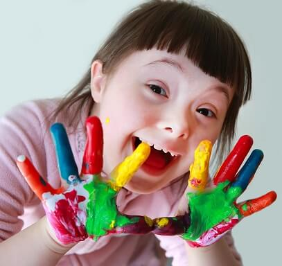 Child with paint all over her hands